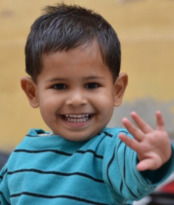 child waving