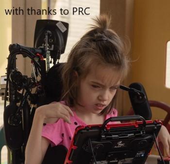 girl using AAC device