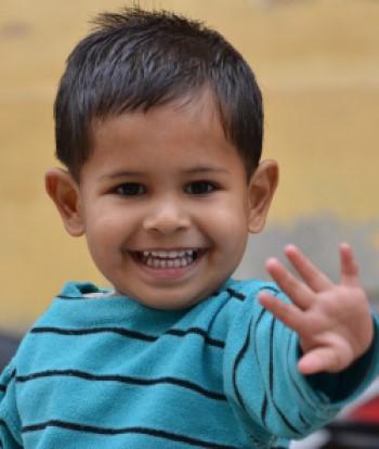child waving