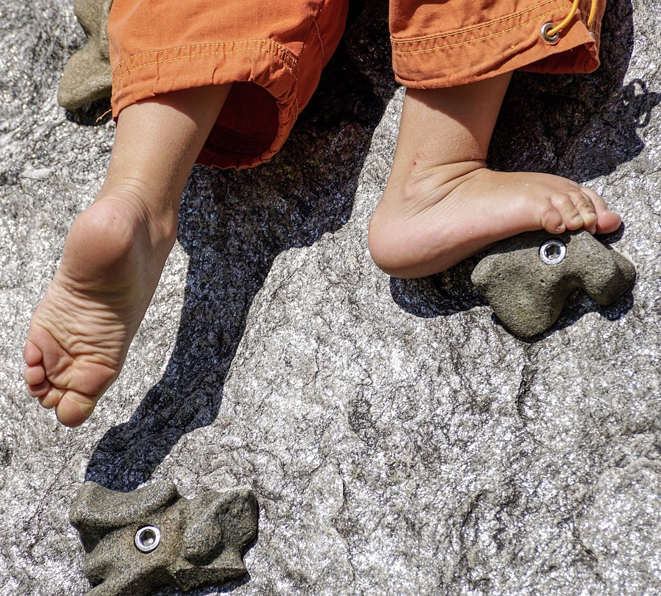 child climbing barefoot